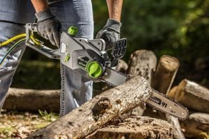 cutting woods with chainsaw